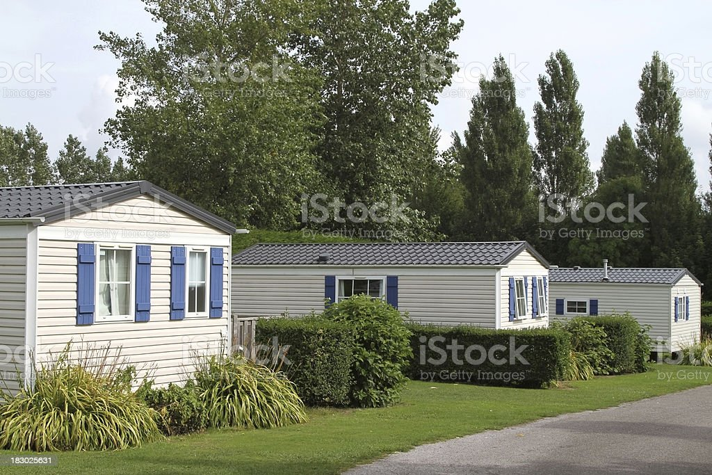 Vacation static holiday caravans in a country woodland setting royalty-free stock photo