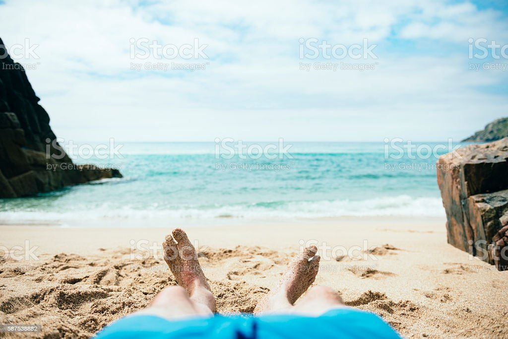 POV Vacation, sunbathing Pedn Vounder Beach, Cornwall stock photo