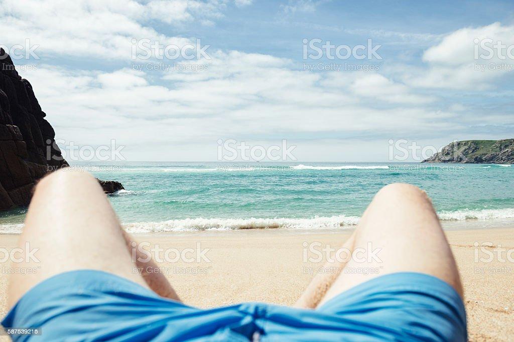 POV Vacation, sunbathing Pedn Vounder Beach, Cornwall stock photo