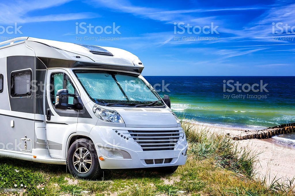 Vacation with motor home at the seaside stock photo
