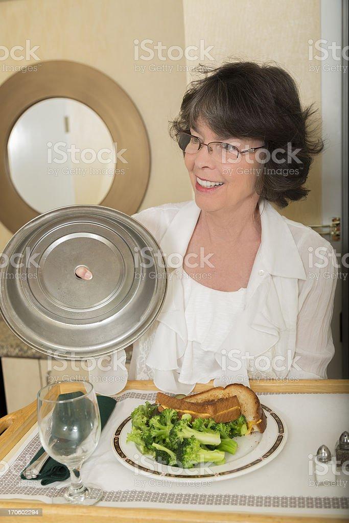 Vacation:  Woman holding room service tray. stock photo