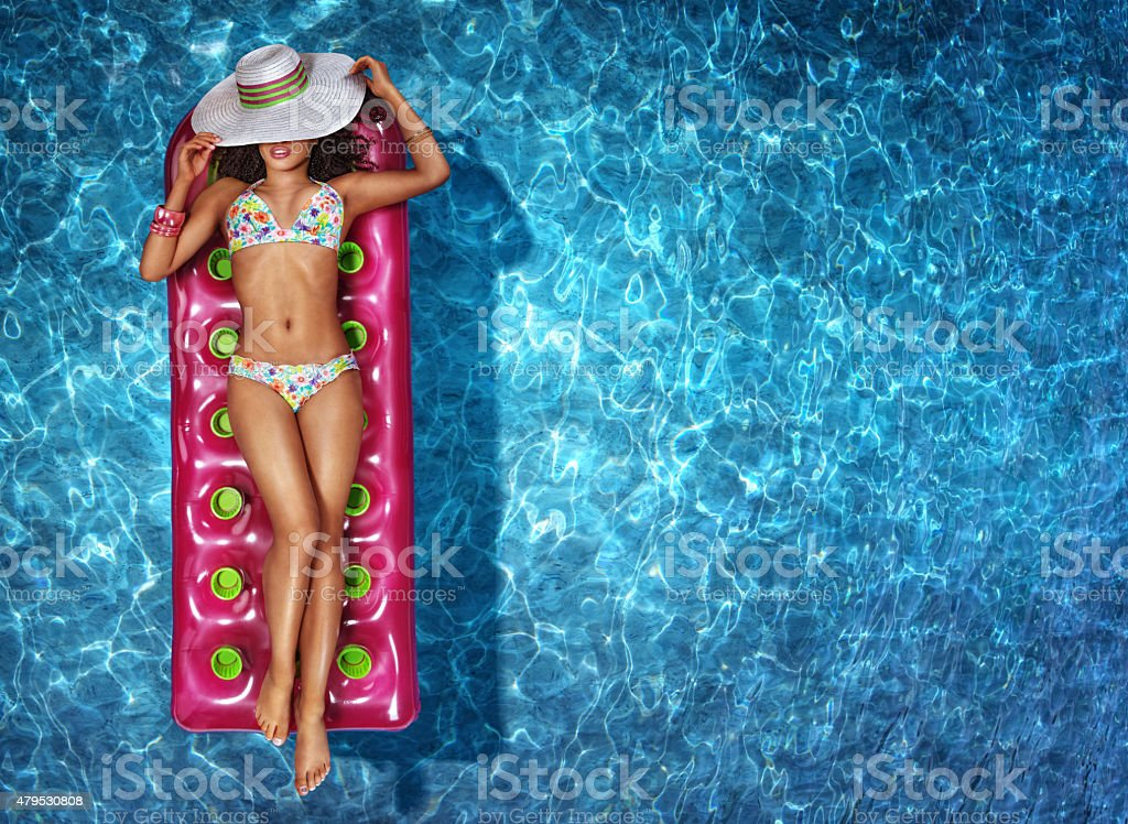 Vacation. Woman is Relaxing in a swimming pool stock photo