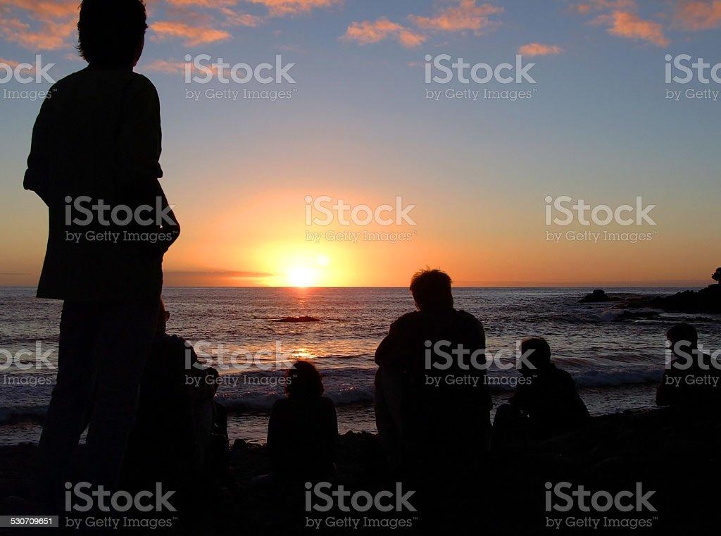 Vacationers enjoy the sunset royalty-free stock photo