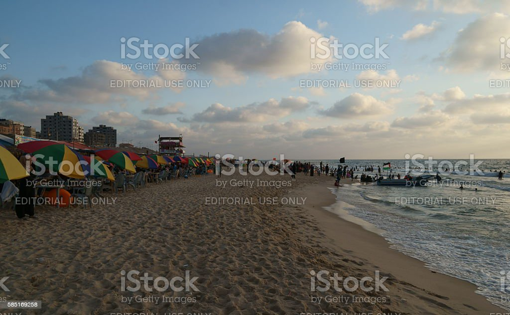 Vacationers fleeing from hot weather and unaffordable resorts to beach stock photo