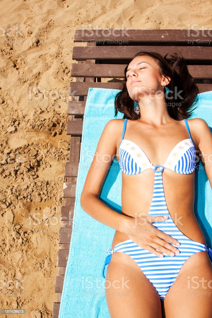 Vacationers girl at the beach royalty-free stock photo