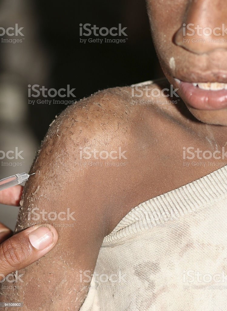 Vaccine Injection in third world country stock photo