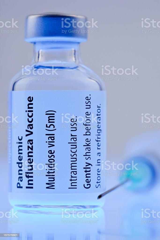 H1N1 vaccine with syringe stock photo