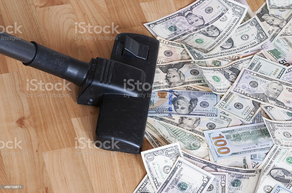 Vacuum cleaner and money royalty-free stock photo