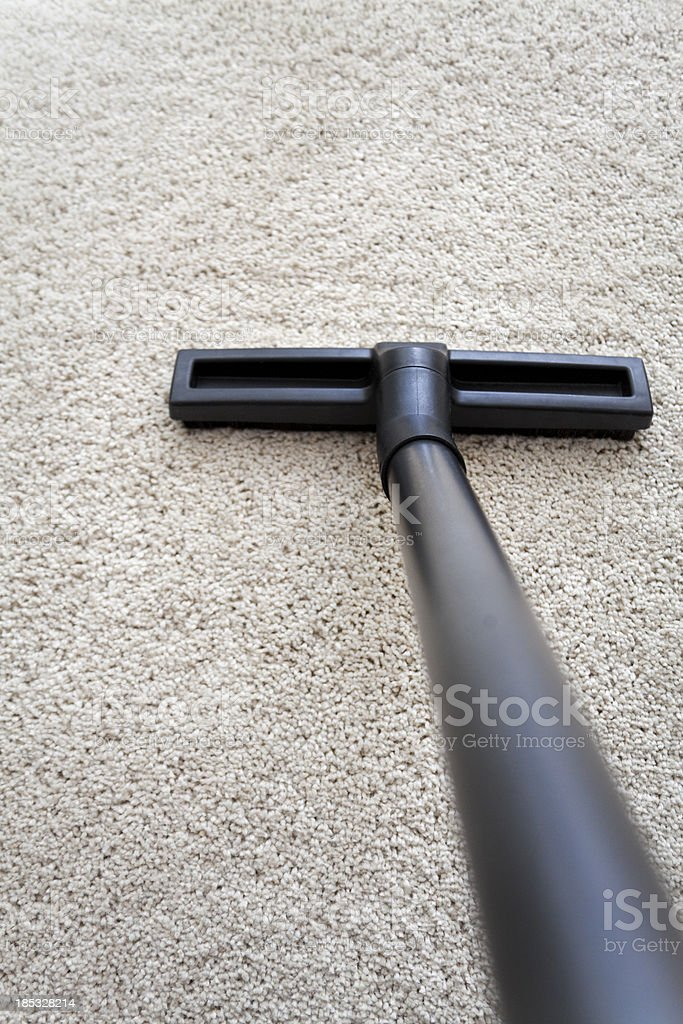 Vacuum cleaner nozzle on carpet stock photo