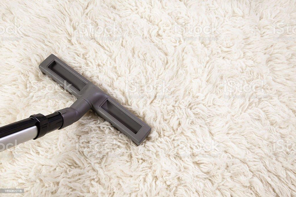 vacuum cleaner nozzle on shag carpet stock photo