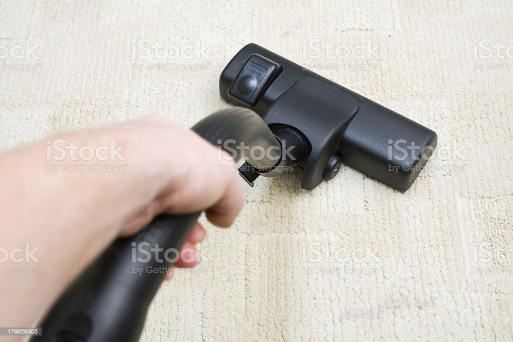 vacuum cleaner on the floor showing house cleaning concept stock photo