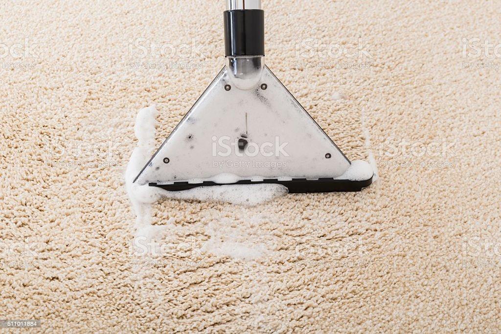 Vacuum Cleaner Over Carpet stock photo