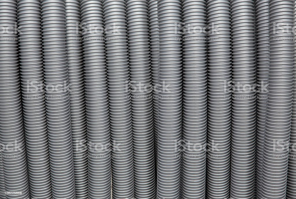 vacuum cleaner pipes as background stock photo