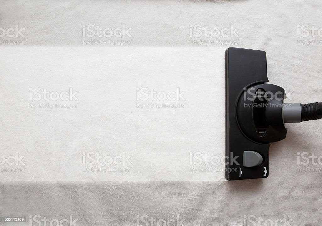 Vacuum cleaner to tidy up. stock photo