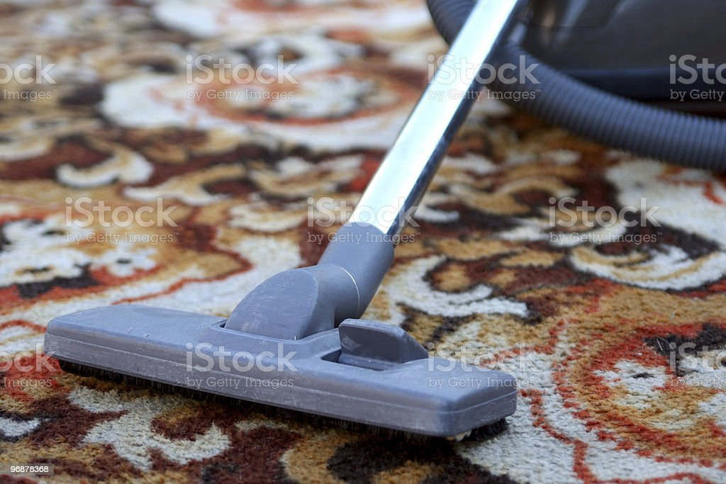 A vacuum cleaning patterned carpet stock photo