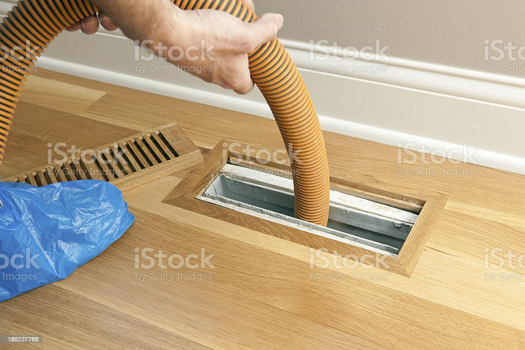 Vacuum Hose Cleaning Floor Vent and Duct stock photo