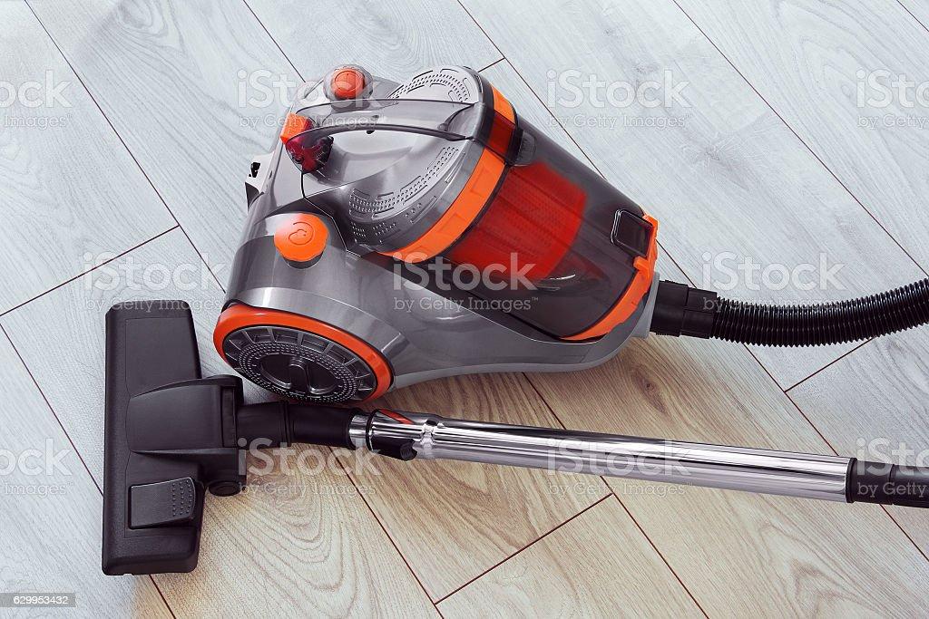 vacuum orange cleaner on gray laminate stock photo