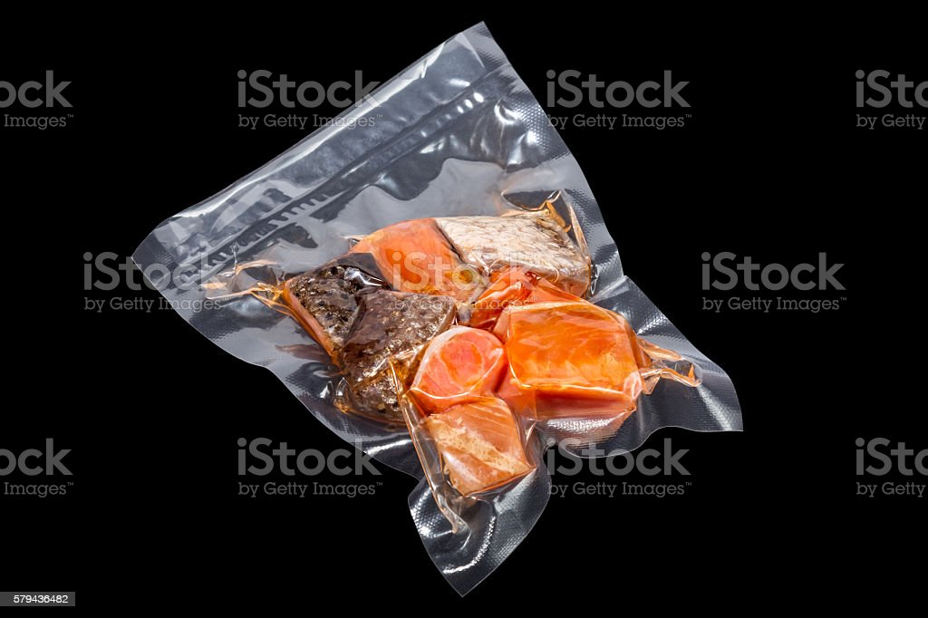 vacuum packaged pieces of salmon stock photo
