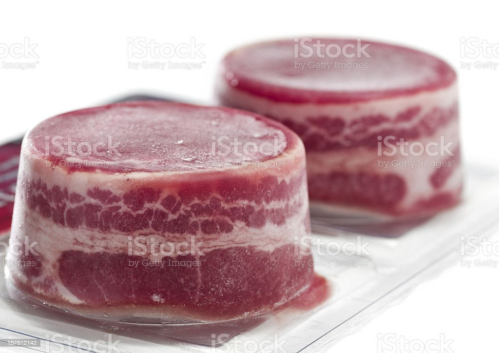 Vacuum packed frozen beef fillets royalty-free stock photo