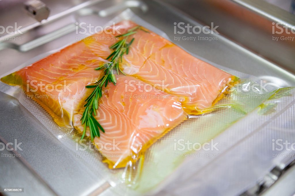 Sous vide salmon with rosemary. stock photo