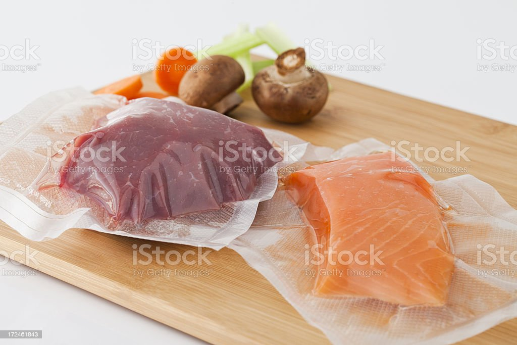 Vacuum Sealed Fresh Meat And Fish royalty-free stock photo