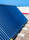 Vacuum solar cells for water heating system