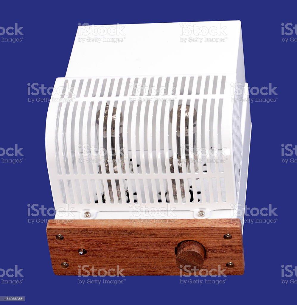 Vacuum Tube Amplifier Isolated on blue stock photo
