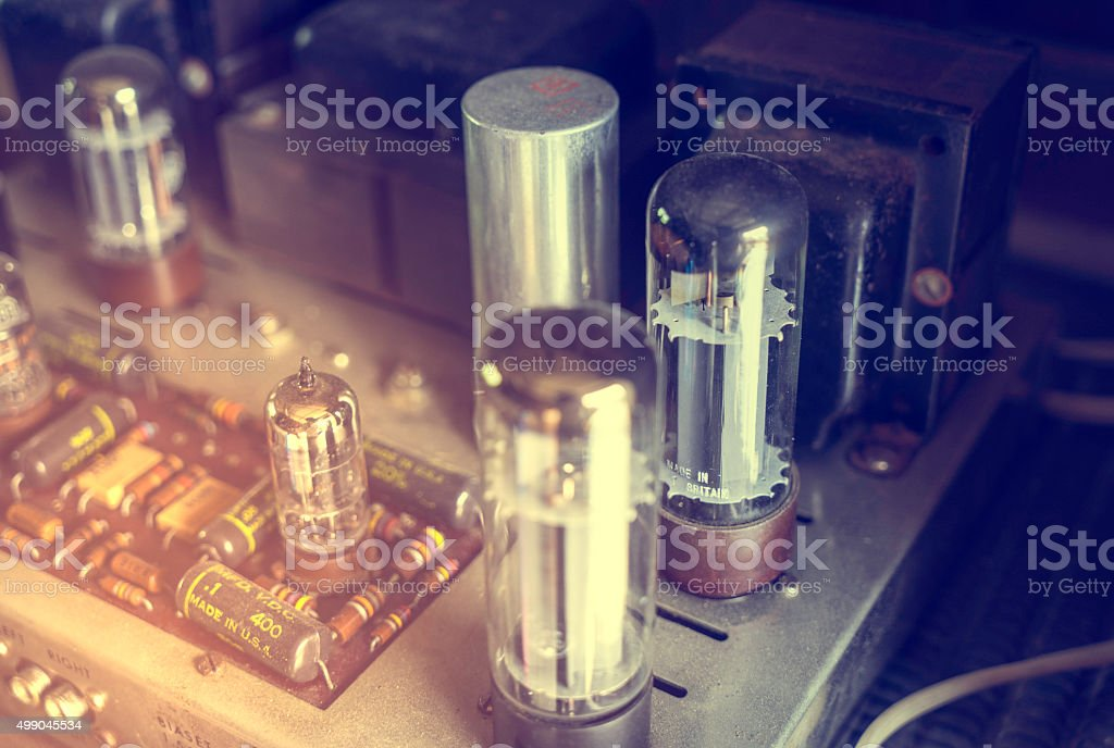 Vacuum Tubes on Audio Amplifier on vintage color stock photo