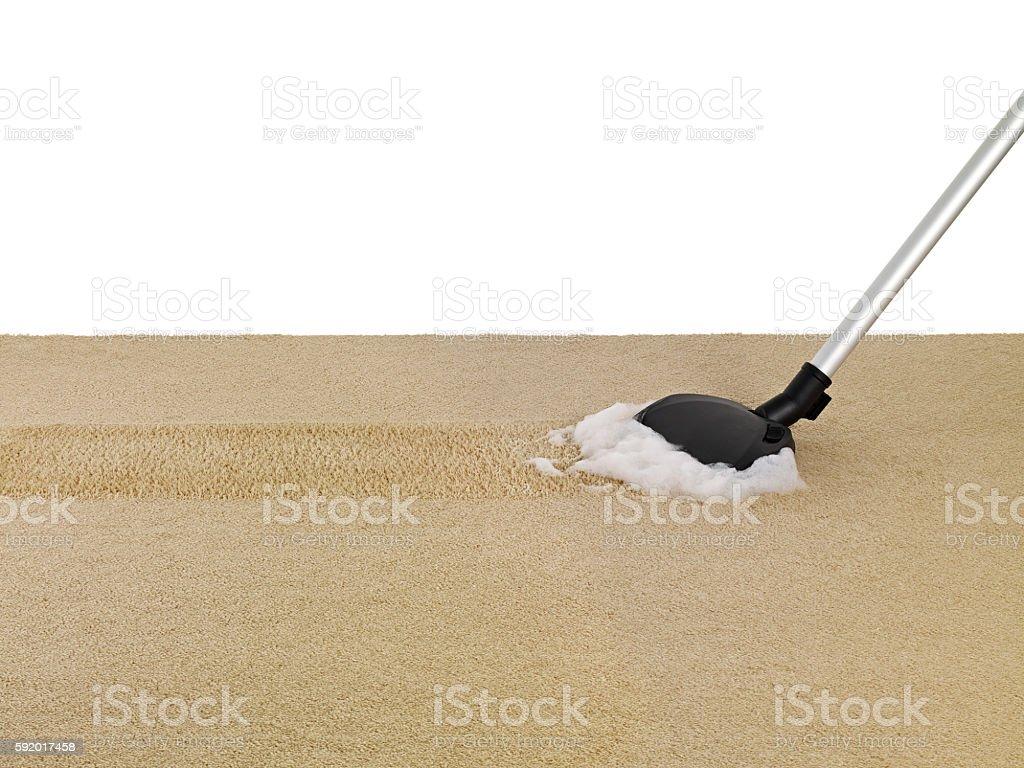 vacuumin the carpet stock photo