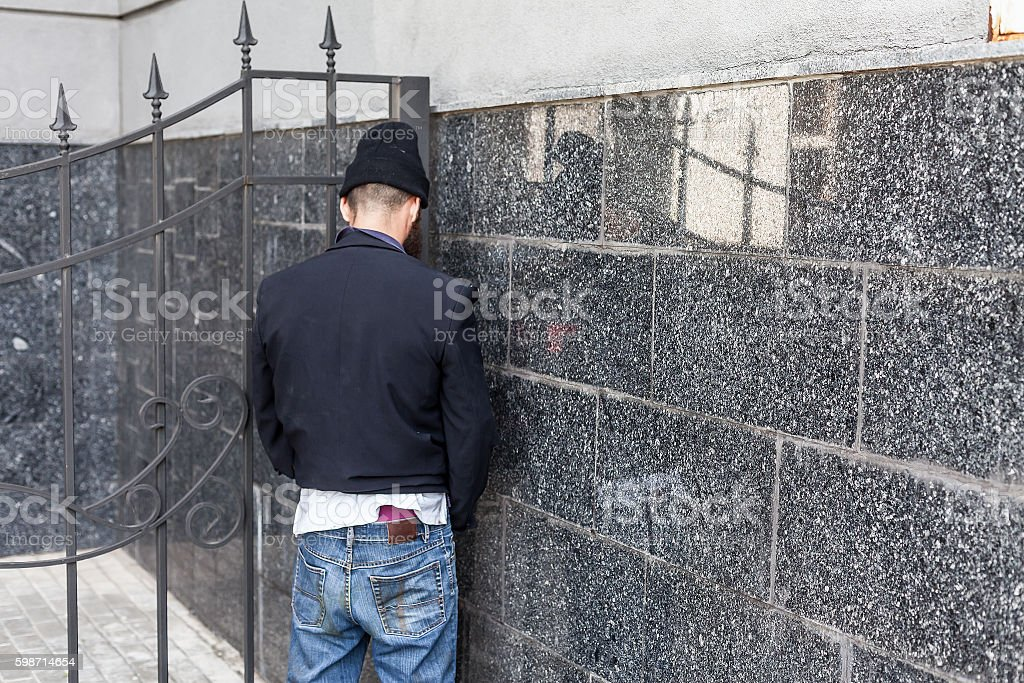 Vagrant peeing stock photo
