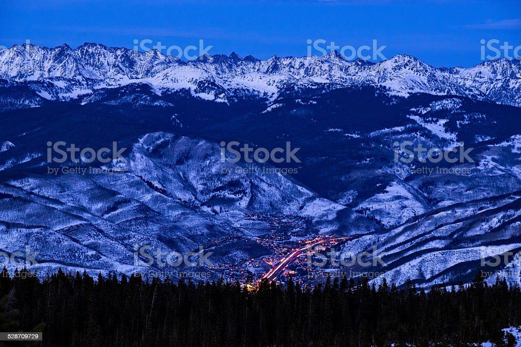 Vail Colorado with Gore Range Mountains at Dusk stock photo