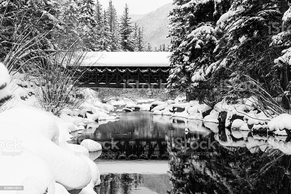 Vail Covered Bridge Gore Creek in Winter stock photo