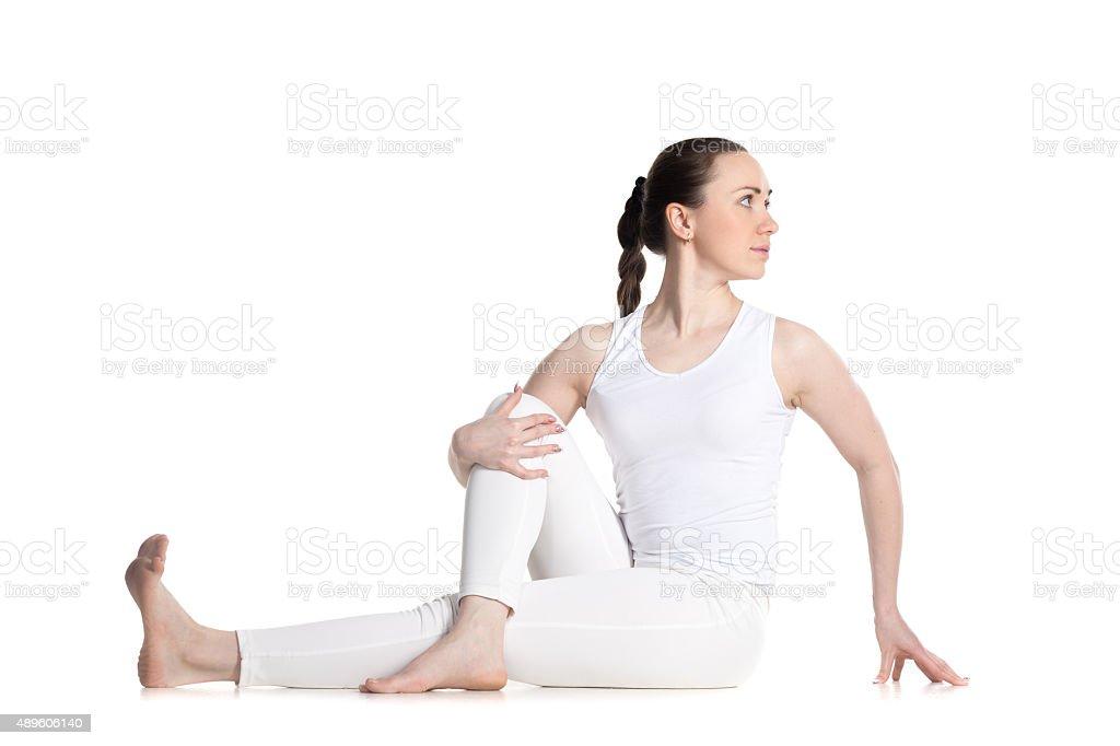 Vakrasana yoga pose stock photo