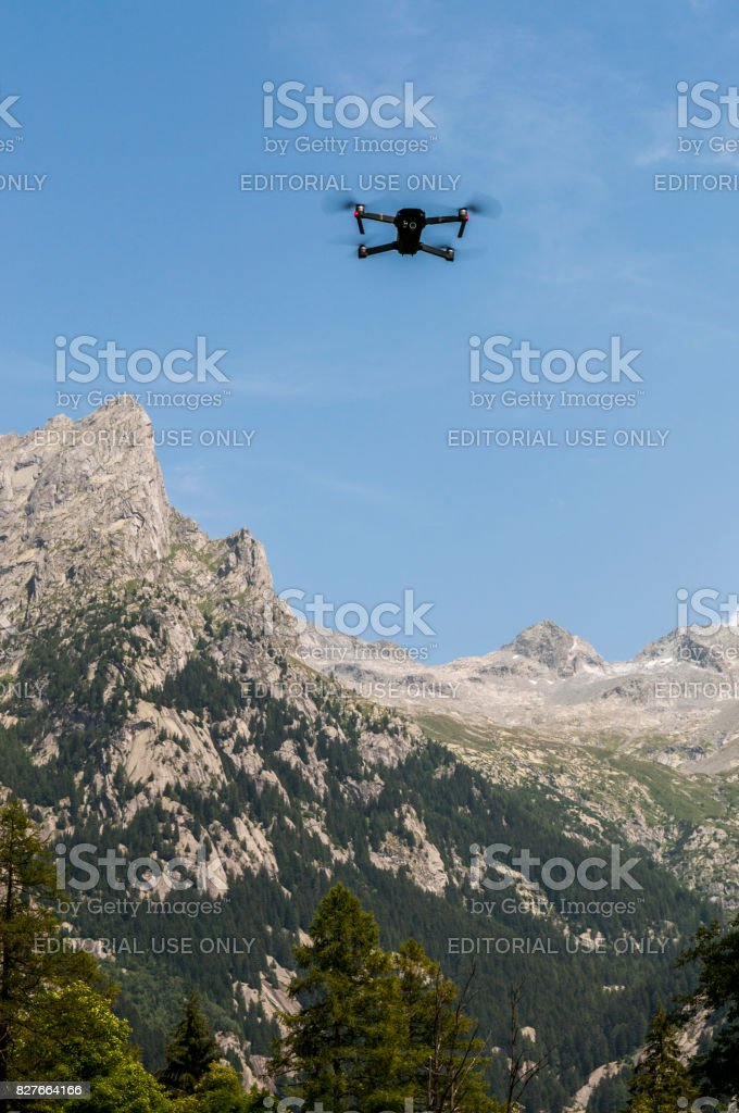 Val Masino: a flying drone in the Val di Mello, green valley surrounded by granite mountains and forest trees stock photo