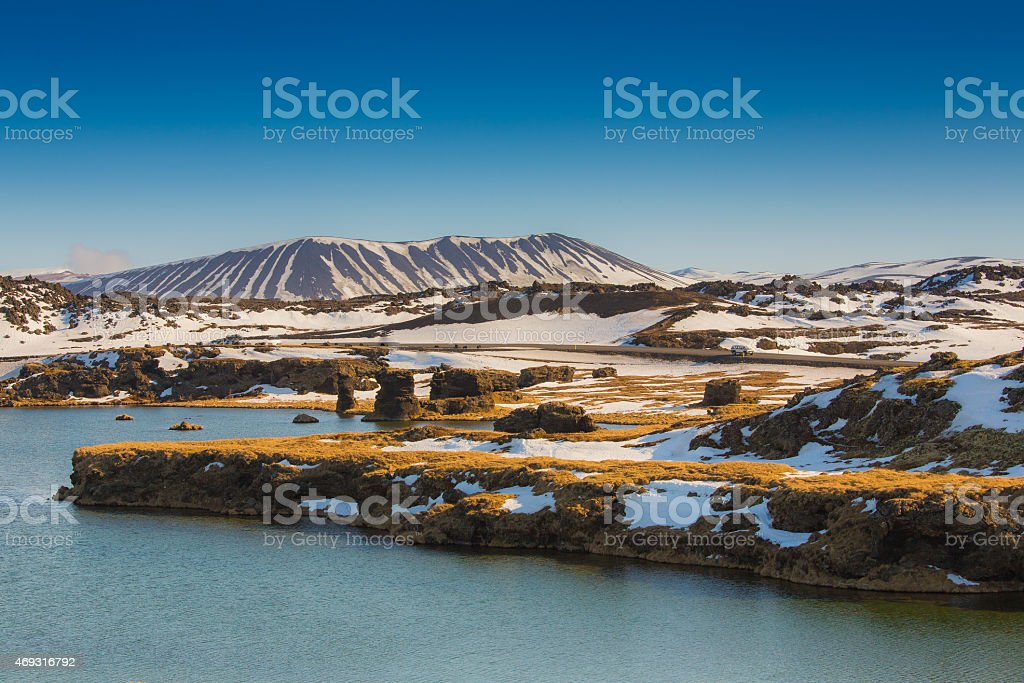 Valcano mount and lake in Myvatn stock photo