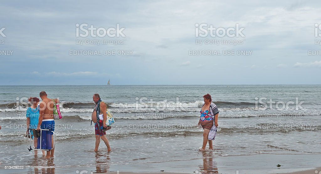 Valencia, Spain, September, 06, 2015, group of beachgoers walking, editorial. stock photo