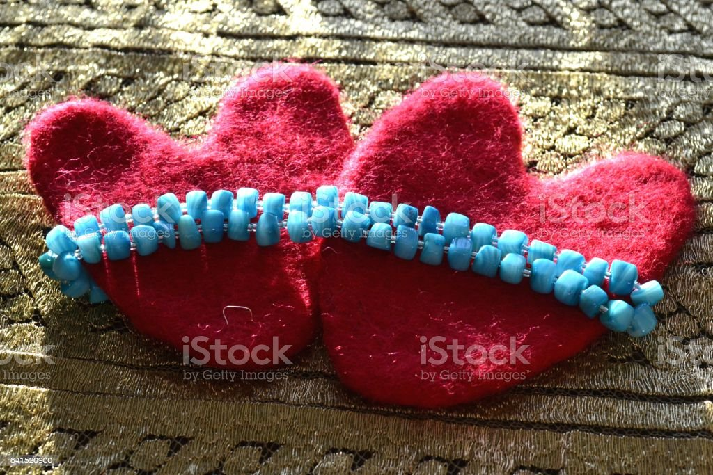 Valentine and beads lie on the canvas stock photo
