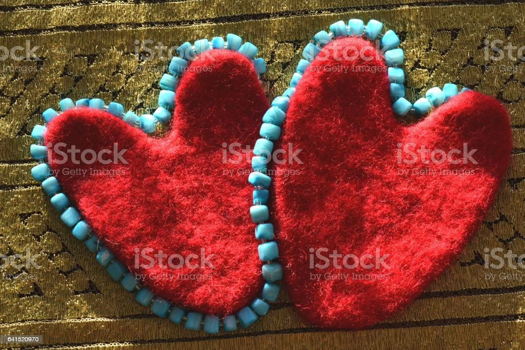 Valentine and blue beads on canvas openwork stock photo