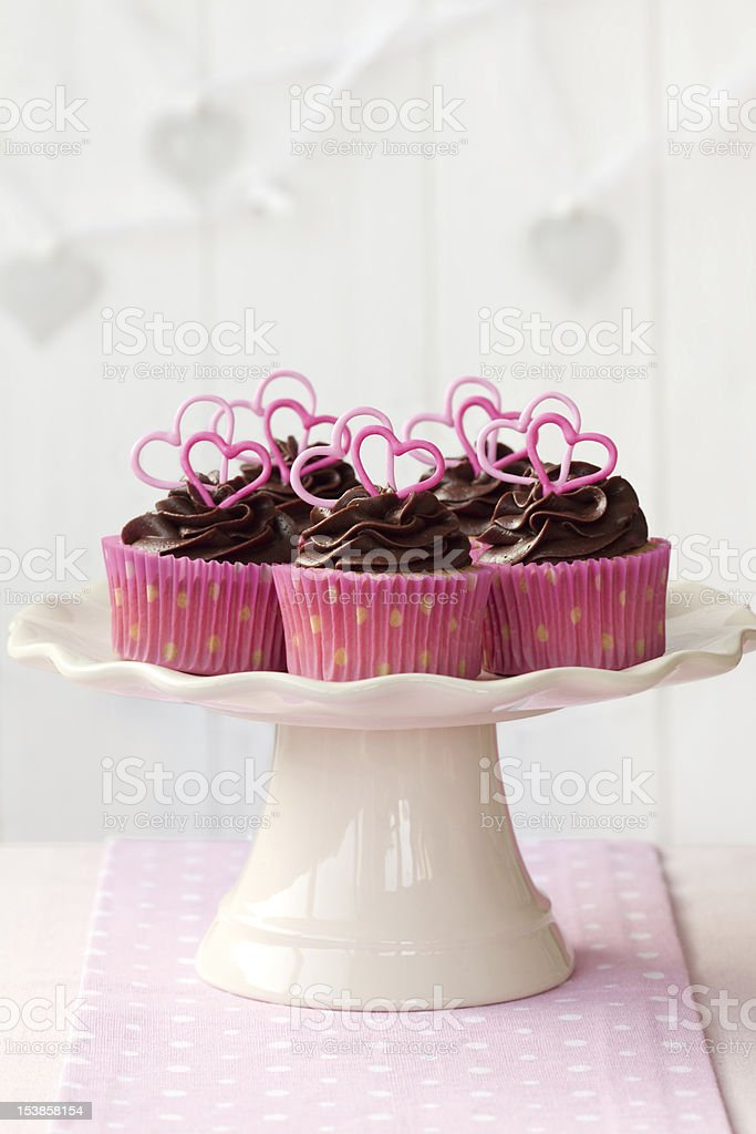 Valentine cupcakes with chocolate and candy hearts stock photo