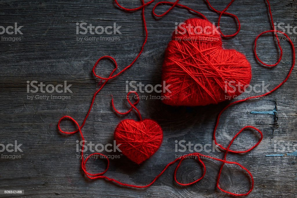 Valentine day postcard mockup with wool handmade red hearts stock photo