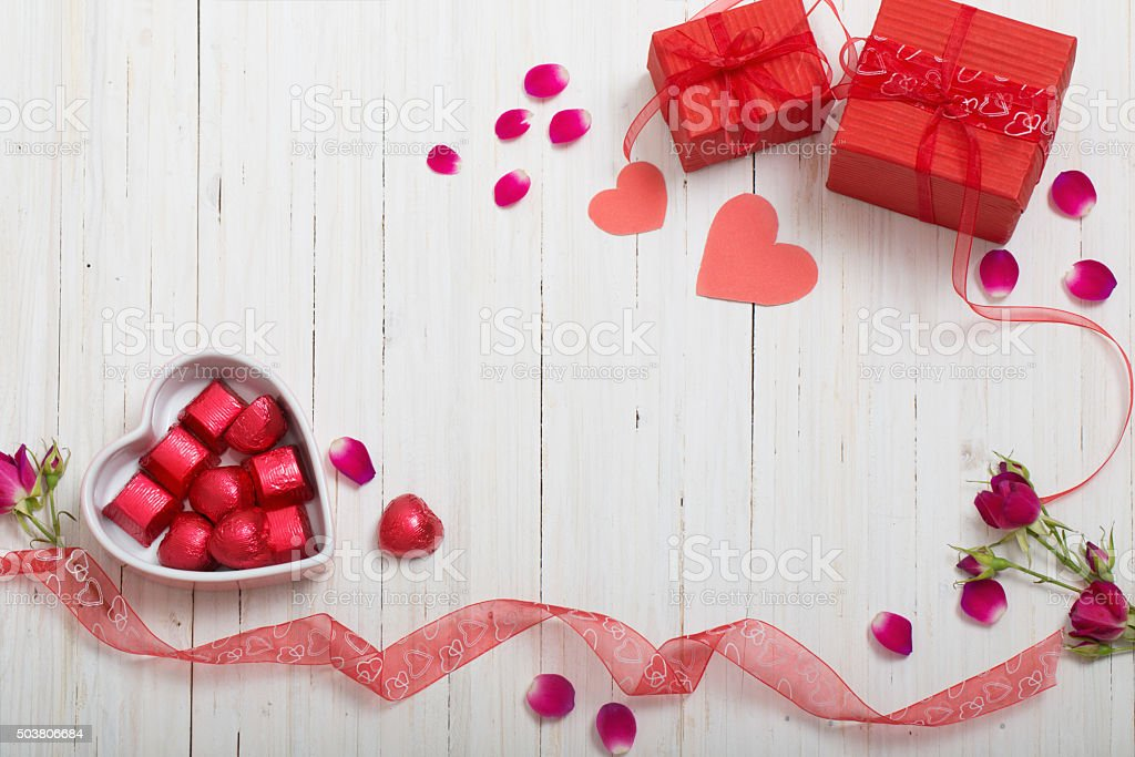 valentine gift box and red heart shapes stock photo
