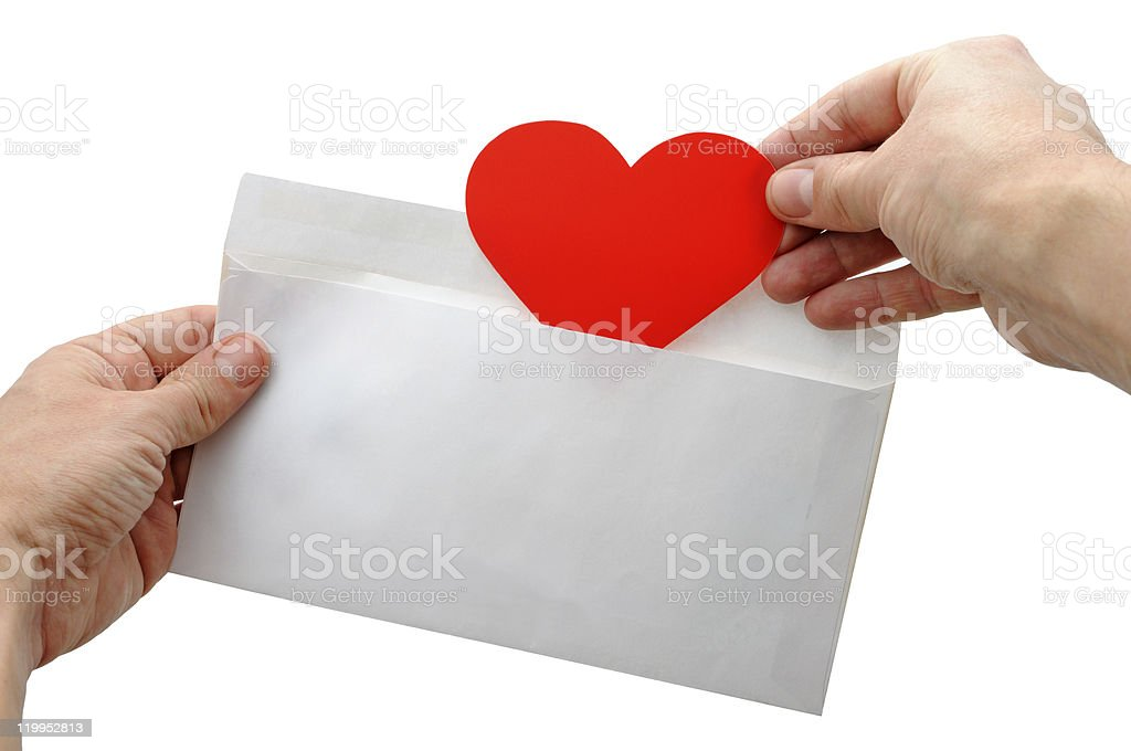 Valentine heart put into envelope royalty-free stock photo