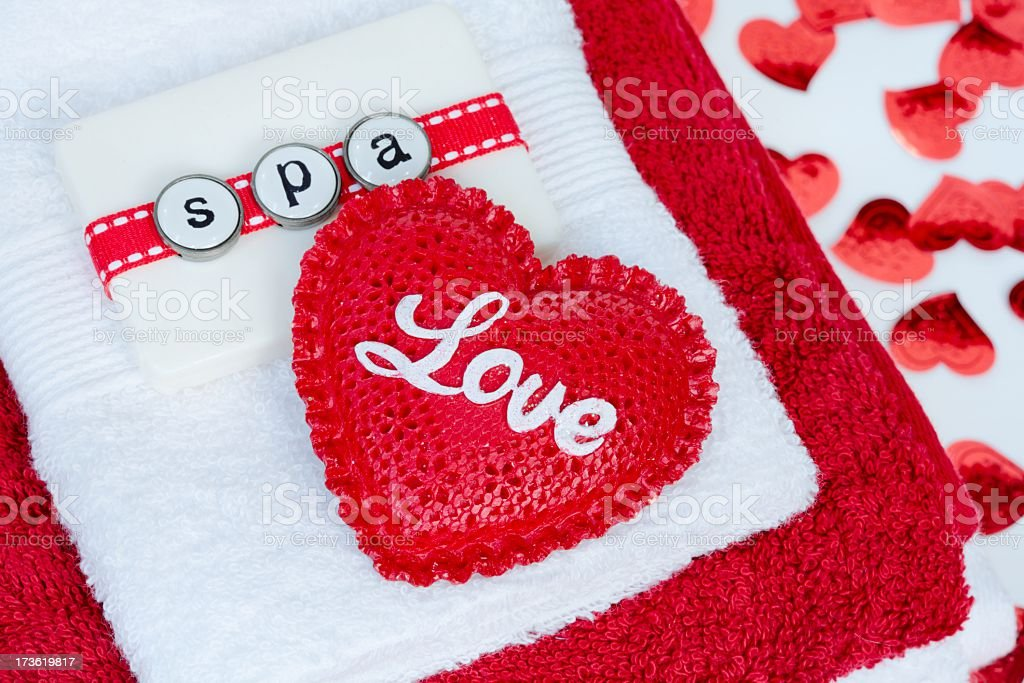 Valentine Spa with red and white towels, confetti hearts, salt stock photo