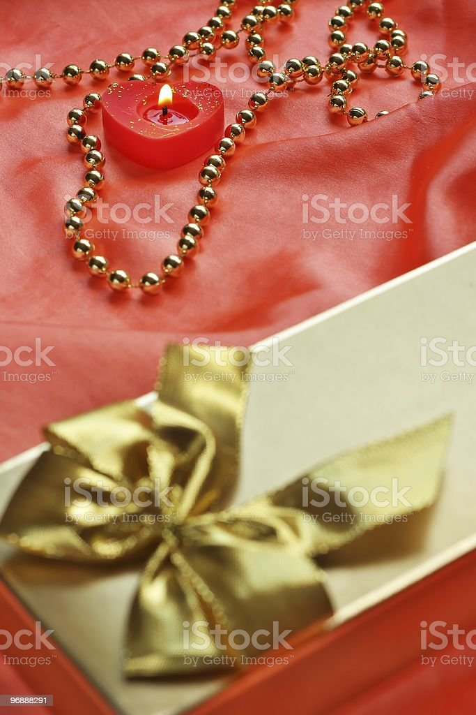 Valentine still-live and gold pearls stock photo