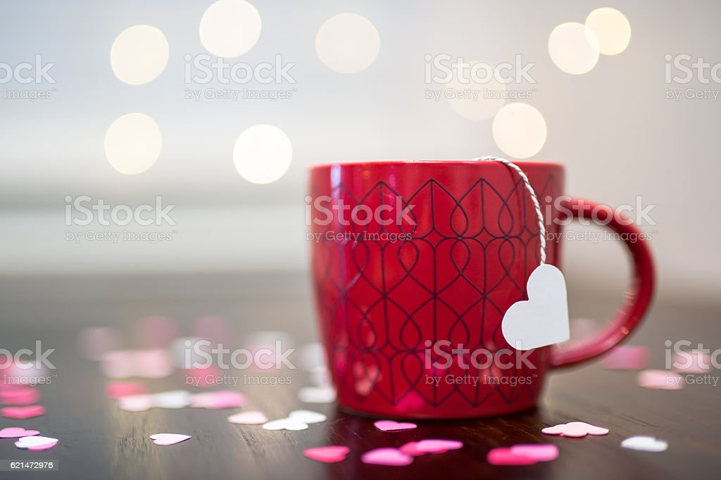 Valentine themed backgrounds with hearts against a wooden backdrop stock photo