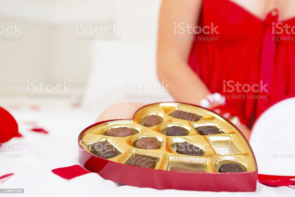 Valentine- Woman in red lingerie and a box of chocolate royalty-free stock photo