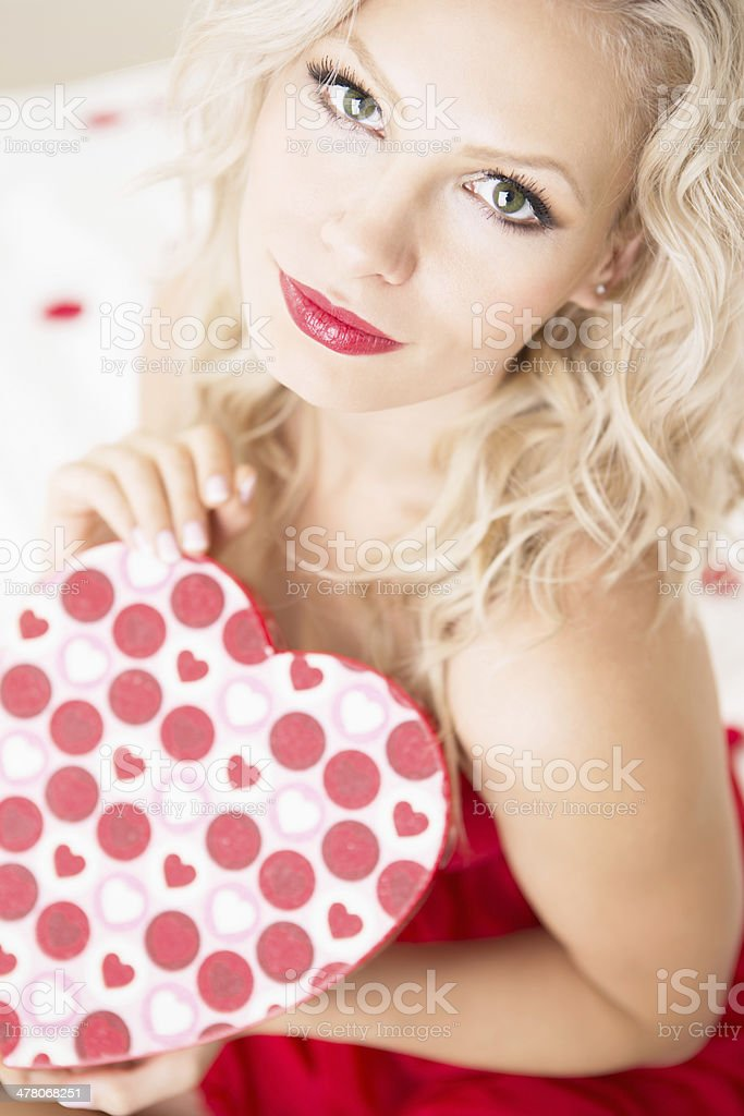 Valentine- Woman in red lingerie holding box of chocolate royalty-free stock photo