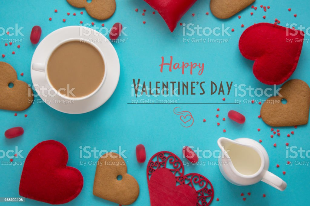 Valentine's card. Cup of black coffee, red heart on blue. stock photo