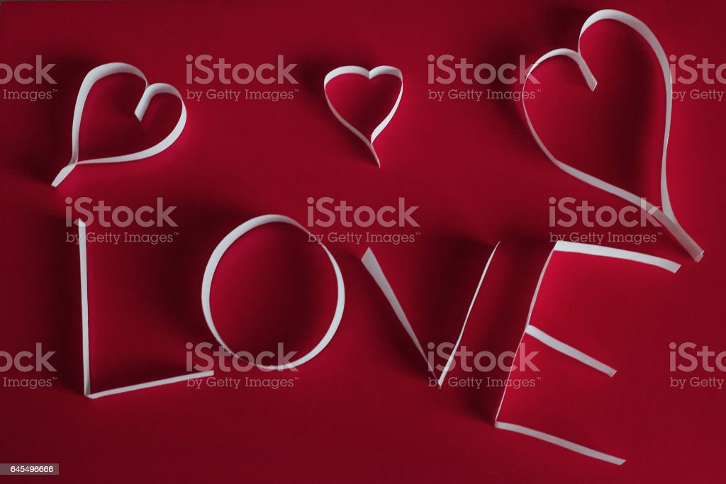 Valentine's day abstract background with cut paper heart stock photo