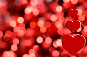 Valentine's Day background with hearts and lights.